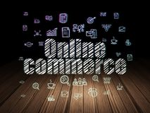 Finance concept: Online Commerce in grunge dark room. Finance concept: Glowing text Online Commerce,  Hand Drawn Business Icons in grunge dark room with Wooden Royalty Free Stock Photos