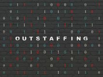 Finance concept: Outstaffing on wall background. Finance concept: Painted white text Outstaffing on Black Brick wall background with Binary Code Royalty Free Stock Images
