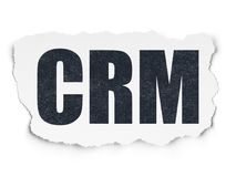 Finance concept: CRM on Torn Paper background. Finance concept: Painted black text CRM on Torn Paper background with Scheme Of Binary Code Royalty Free Stock Photos