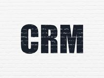 Finance concept: CRM on wall background. Finance concept: Painted black text CRM on White Brick wall background Royalty Free Stock Image