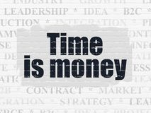 Finance concept: Time Is money on wall background. Finance concept: Painted black text Time Is money on White Brick wall background with  Tag Cloud Royalty Free Stock Images