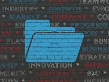 Finance concept: Folder on wall background. Finance concept: Painted blue Folder icon on Black Brick wall background with  Tag Cloud Royalty Free Stock Photography