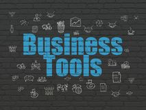 Finance concept: Business Tools on wall background. Finance concept: Painted blue text Business Tools on Black Brick wall background with  Hand Drawn Business Stock Photo