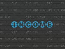 Finance concept: Income on wall background. Finance concept: Painted blue text Income on Black Brick wall background with Currency Stock Photography