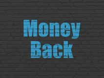 Finance concept: Money Back on wall background. Finance concept: Painted blue text Money Back on Black Brick wall background Stock Photo