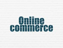 Finance concept: Online Commerce on wall background. Finance concept: Painted blue text Online Commerce on White Brick wall background Stock Photos