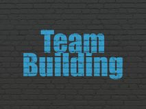 Finance concept: Team Building on wall background. Finance concept: Painted blue text Team Building on Black Brick wall background Stock Photo