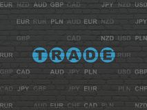 Finance concept: Trade on wall background. Finance concept: Painted blue text Trade on Black Brick wall background with Currency Stock Images