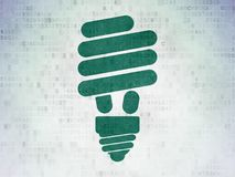 Finance concept: Energy Saving Lamp on Digital Data Paper background. Finance concept: Painted green Energy Saving Lamp icon on Digital Data Paper background Stock Photos