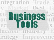 Finance concept: Business Tools on wall background. Finance concept: Painted green text Business Tools on White Brick wall background with  Tag Cloud Stock Photography