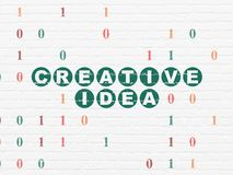 Finance concept: Creative Idea on wall background. Finance concept: Painted green text Creative Idea on White Brick wall background with Binary Code Royalty Free Stock Images
