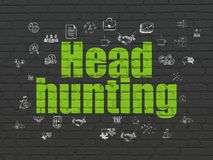 Finance concept: Head Hunting on wall background. Finance concept: Painted green text Head Hunting on Black Brick wall background with  Hand Drawn Business Icons Royalty Free Stock Image