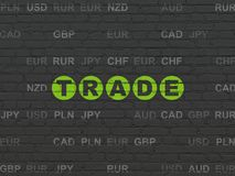 Finance concept: Trade on wall background. Finance concept: Painted green text Trade on Black Brick wall background with Currency Royalty Free Stock Photo