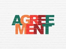 Finance concept: Agreement on wall background. Finance concept: Painted multicolor text Agreement on White Brick wall background Royalty Free Stock Images
