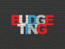 Finance concept: Budgeting on wall background. Finance concept: Painted multicolor text Budgeting on Black Brick wall background Royalty Free Stock Photo