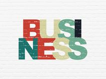 Finance concept: Business on wall background. Finance concept: Painted multicolor text Business on White Brick wall background Royalty Free Stock Images