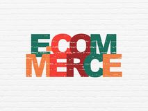 Finance concept: E-commerce on wall background. Finance concept: Painted multicolor text E-commerce on White Brick wall background Stock Images
