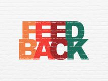 Finance concept: Feedback on wall background. Finance concept: Painted multicolor text Feedback on White Brick wall background Royalty Free Stock Images