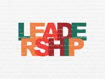 Finance concept: Leadership on wall background. Finance concept: Painted multicolor text Leadership on White Brick wall background Stock Images
