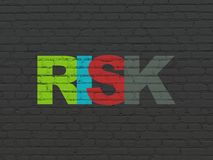 Finance concept: Risk on wall background. Finance concept: Painted multicolor text Risk on Black Brick wall background Royalty Free Stock Photography