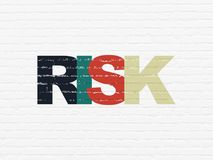Finance concept: Risk on wall background. Finance concept: Painted multicolor text Risk on White Brick wall background Royalty Free Stock Image
