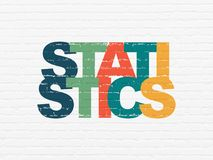 Finance concept: Statistics on wall background. Finance concept: Painted multicolor text Statistics on White Brick wall background Royalty Free Stock Photo