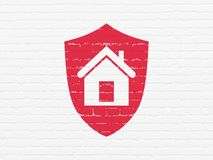 Finance concept: Shield on wall background. Finance concept: Painted red Shield icon on White Brick wall background Stock Photography