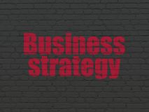 Finance concept: Business Strategy on wall background. Finance concept: Painted red text Business Strategy on Black Brick wall background Stock Image