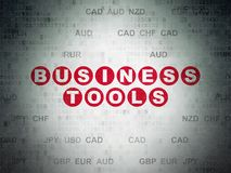 Finance concept: Business Tools on Digital Data Paper background. Finance concept: Painted red text Business Tools on Digital Data Paper background with Currency Royalty Free Stock Images
