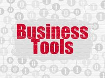 Finance concept: Business Tools on wall background. Finance concept: Painted red text Business Tools on White Brick wall background with Scheme Of Binary Code Stock Image