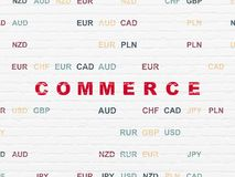 Finance concept: Commerce on wall background. Finance concept: Painted red text Commerce on White Brick wall background with Currency Stock Photography