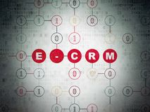 Finance concept: E-CRM on Digital Data Paper background. Finance concept: Painted red text E-CRM on Digital Data Paper background with Binary Code Stock Image