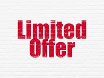 Finance concept: Limited Offer on wall background. Finance concept: Painted red text Limited Offer on White Brick wall background Royalty Free Stock Images
