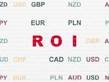 Finance concept: ROI on wall background. Finance concept: Painted red text ROI on White Brick wall background with Currency Royalty Free Stock Photos