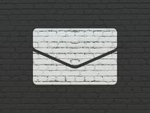 Finance concept: Email on wall background. Finance concept: Painted white Email icon on Black Brick wall background Royalty Free Stock Images