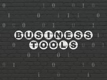 Finance concept: Business Tools on wall background. Finance concept: Painted white text Business Tools on Black Brick wall background with Binary Code Royalty Free Stock Photos