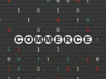 Finance concept: commerce on wall background. Finance concept: painted white text commerce on black brick wall background with binary code Royalty Free Stock Photography