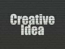 Finance concept: Creative Idea on wall background. Finance concept: Painted white text Creative Idea on Black Brick wall background Royalty Free Stock Images