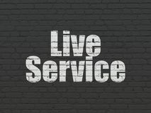Finance concept: Live Service on wall background. Finance concept: Painted white text Live Service on Black Brick wall background Stock Photos