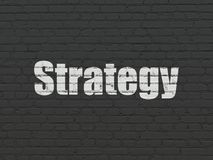 Finance concept: Strategy on wall background. Finance concept: Painted white text Strategy on Black Brick wall background Royalty Free Stock Images