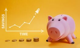 Finance concept. piggy bank and extremely rising as rocket coins chart. On yellow background stock image