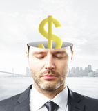 Finance concept. Portrait of handsome caucasian businessman with closed eyes and abstract dollar sign inside head on city background. Finance concept Stock Photos