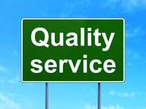 Finance concept: Quality Service on road sign background. Finance concept: Quality Service on green road highway sign, clear blue sky background, 3D rendering Stock Images