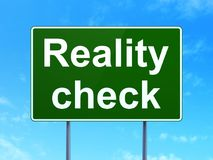 Finance concept: Reality Check on road sign background. Finance concept: Reality Check on green road highway sign, clear blue sky background, 3D rendering Stock Photography