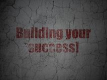Finance concept: Building your Success! on grunge wall background. Finance concept: Red Building your Success! on grunge textured concrete wall background Stock Photography