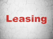Finance concept: Leasing on wall background. Finance concept: Red Leasing on textured concrete wall background Stock Photo