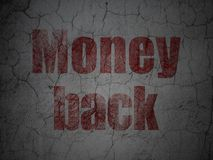 Finance concept: Money Back on grunge wall background. Finance concept: Red Money Back on grunge textured concrete wall background Stock Photography