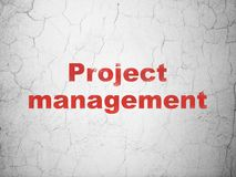 Finance concept: Project Management on wall background. Finance concept: Red Project Management on textured concrete wall background Royalty Free Stock Photos