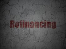 Finance concept: Refinancing on grunge wall background. Finance concept: Red Refinancing on grunge textured concrete wall background Stock Image