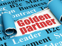 Finance concept: red text Golden Partner under the piece of  torn paper Stock Images